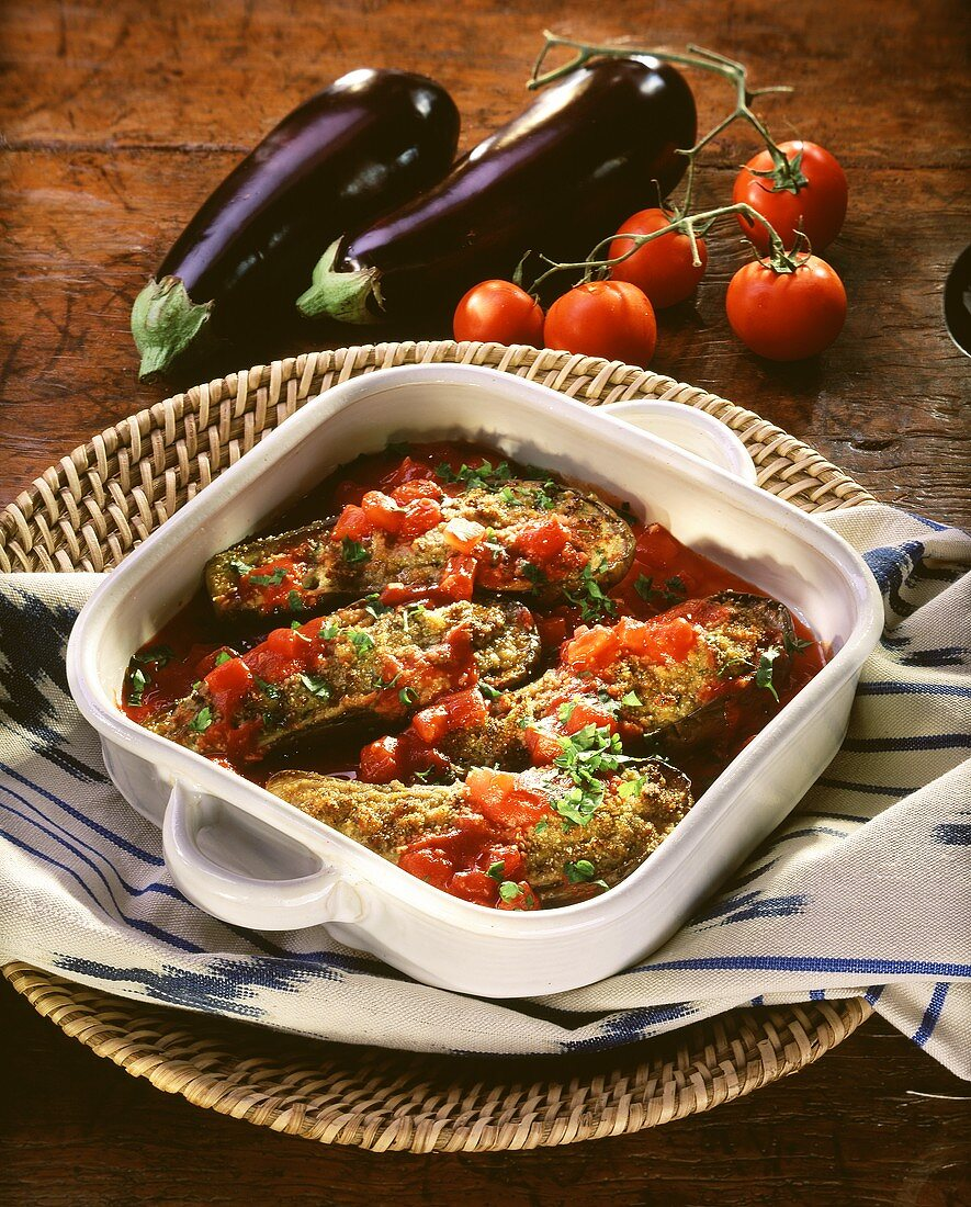 Aubergines with mince stuffing and tomato sauce