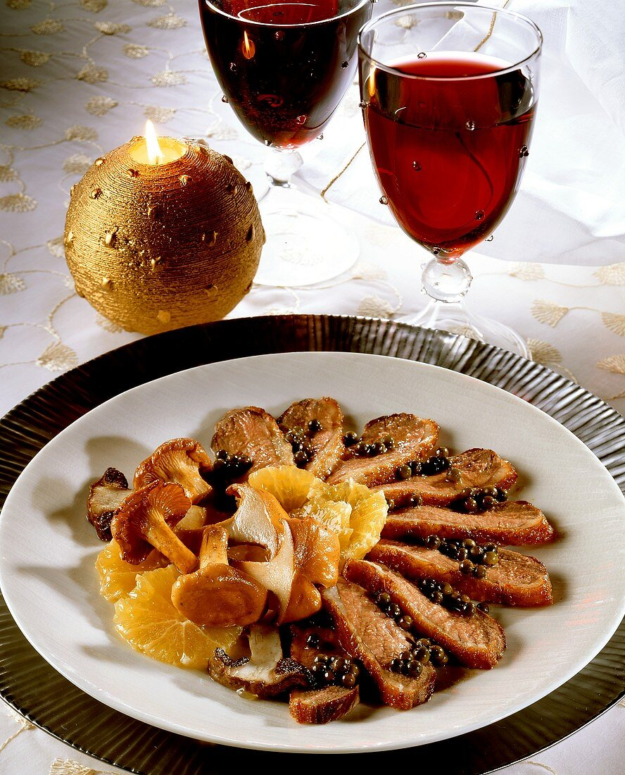 Duck breast with orange slices, green peppers and mushrooms