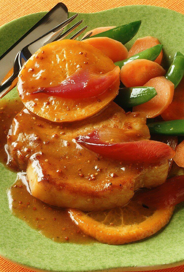 Pork steak with orange & mustard sauce & orange slices