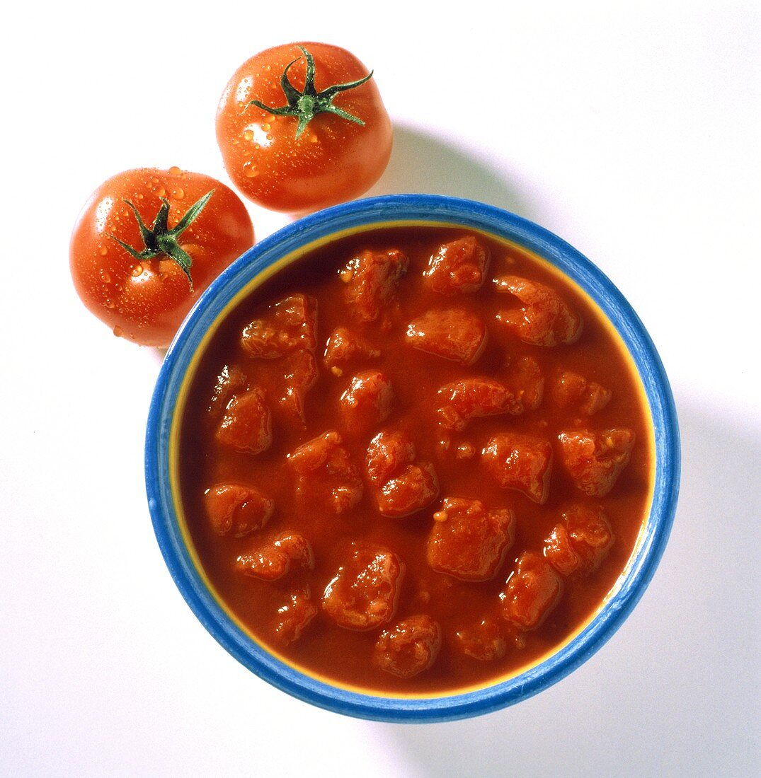 Bowl of fresh tomato sauce with chopped tomato pieces