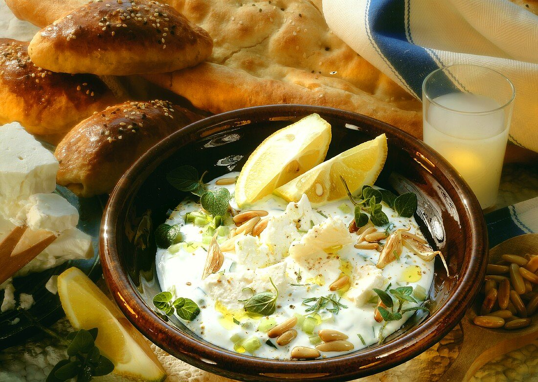 Cold cucumber & yoghurt soup with sheep's cheese & pine nuts