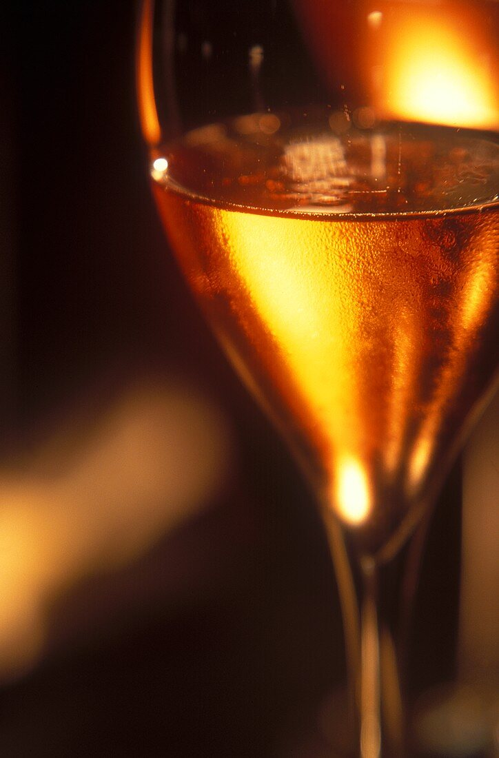 A glass of sparkling Rose Ruinart, Champagne, France