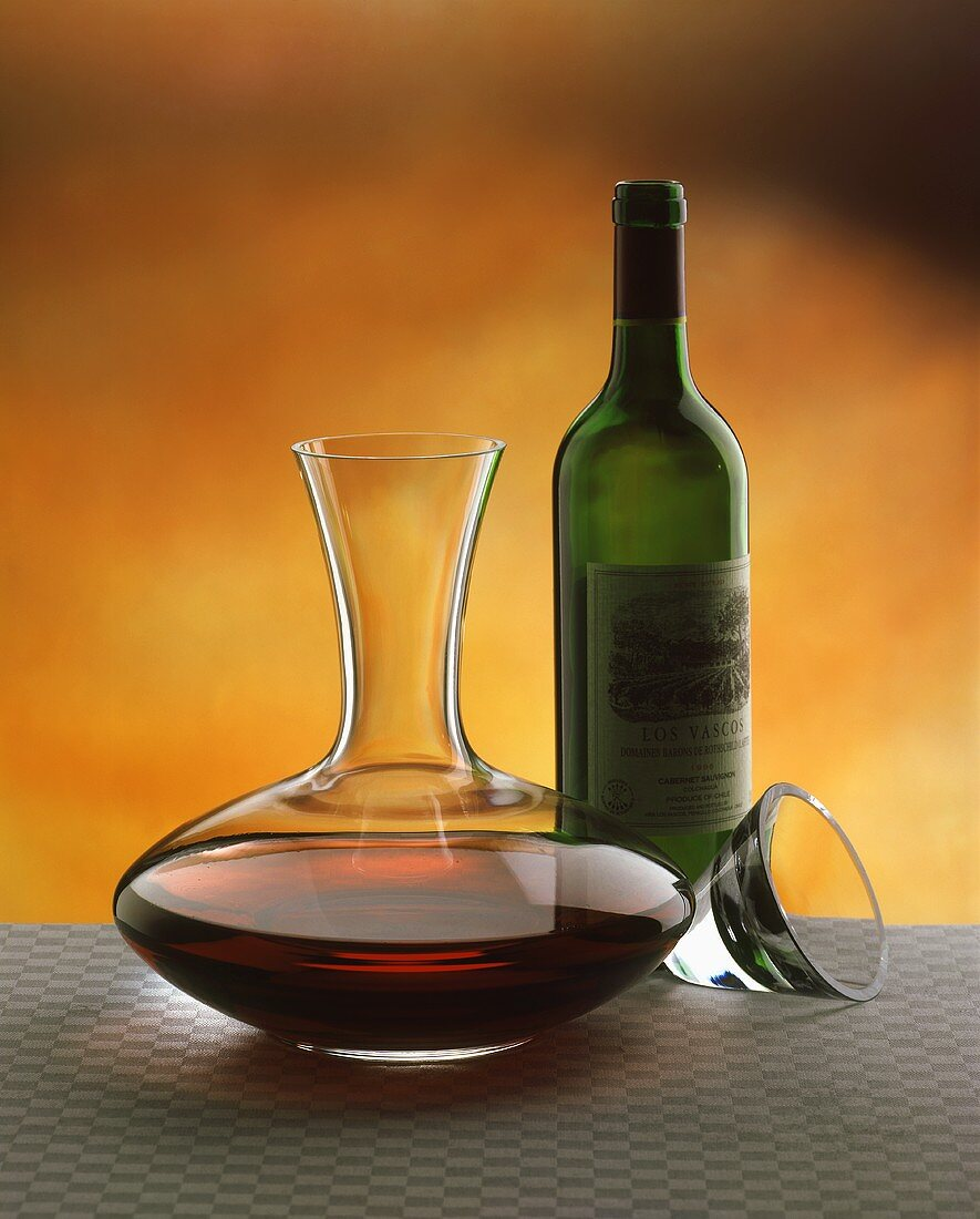 Decanting: filled carafe, empty red wine bottle
