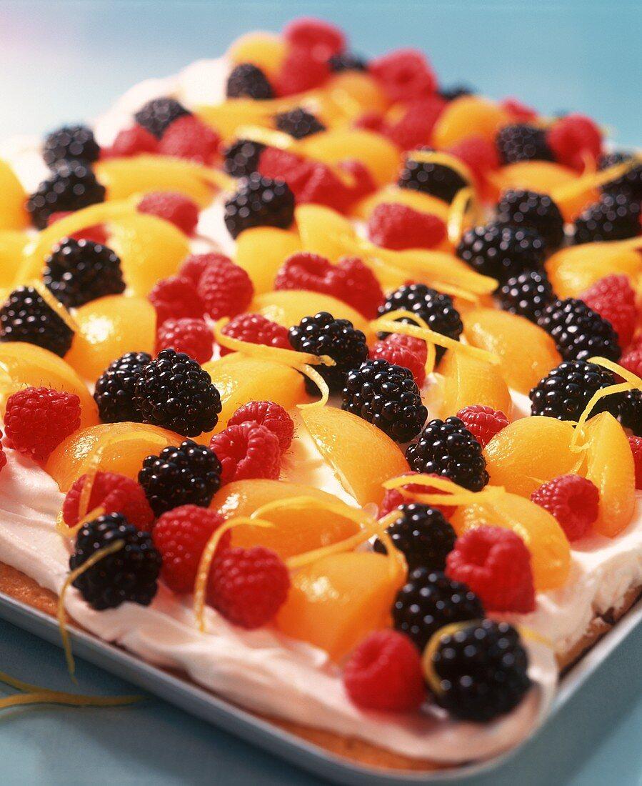 Tray-baked lemon cake with fruit topping