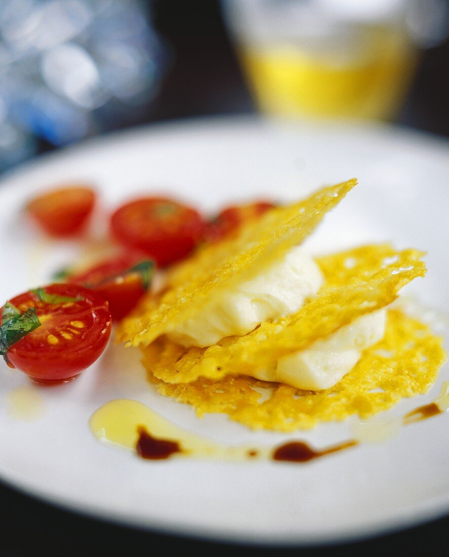 Thin potato pancake with soft cheese mousse & tomatoes