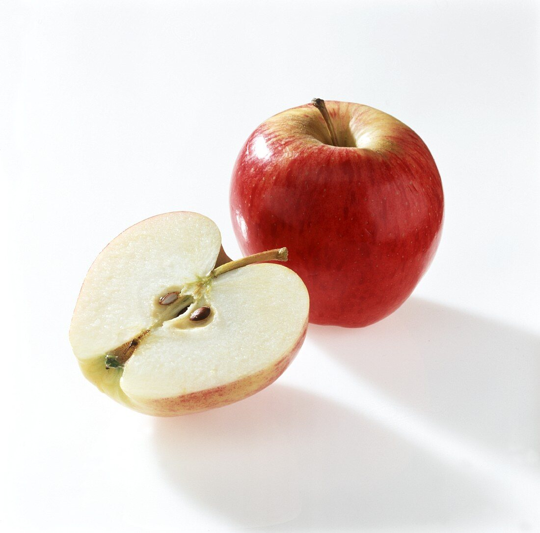 A half and a whole Gloster apple