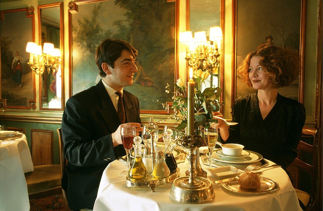 Young couple in Restaurant Laperouse in Paris