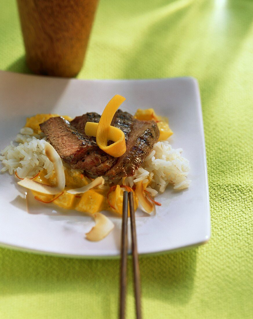 Ostrich steak with mango and coconut sauce