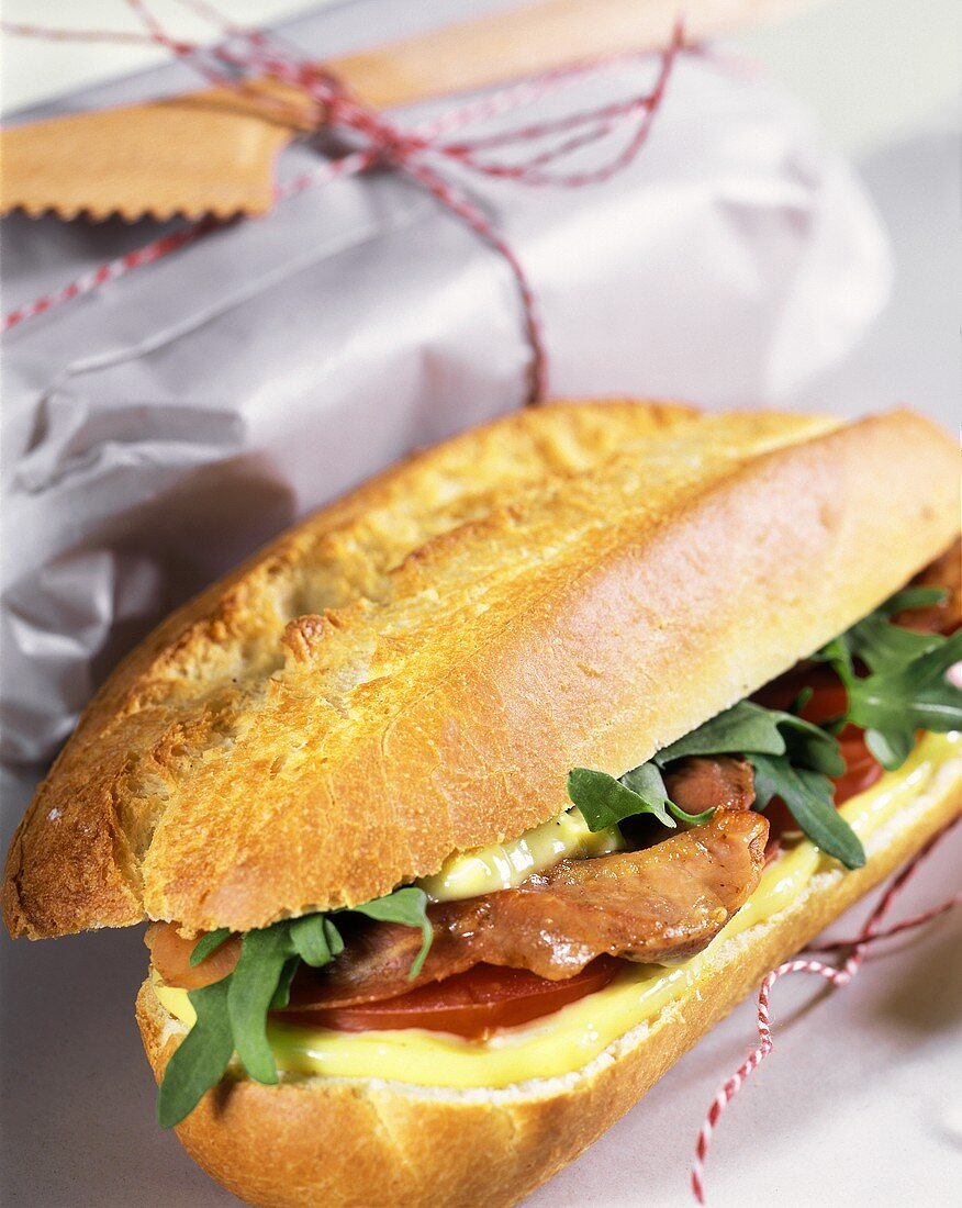 Baguette roll with cheese, ham and tomatoes