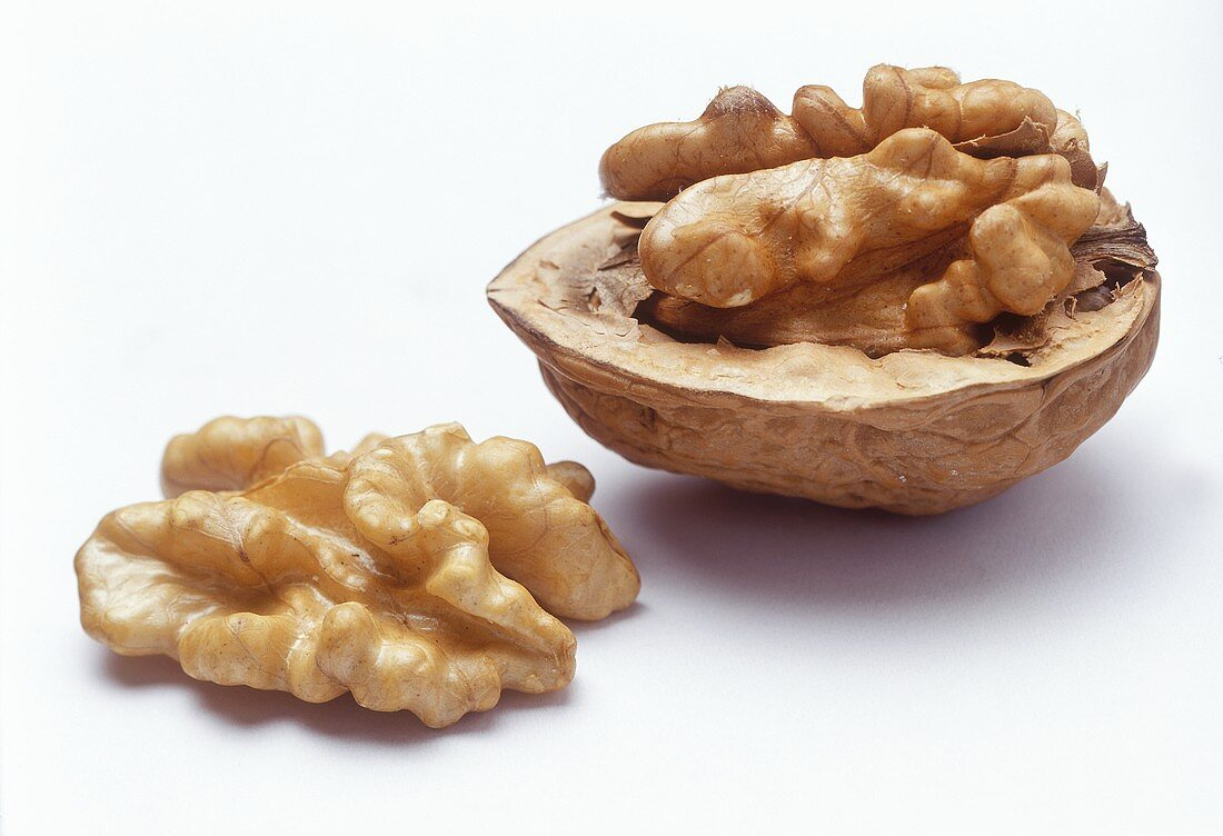 Two walnut halves, with and without shell