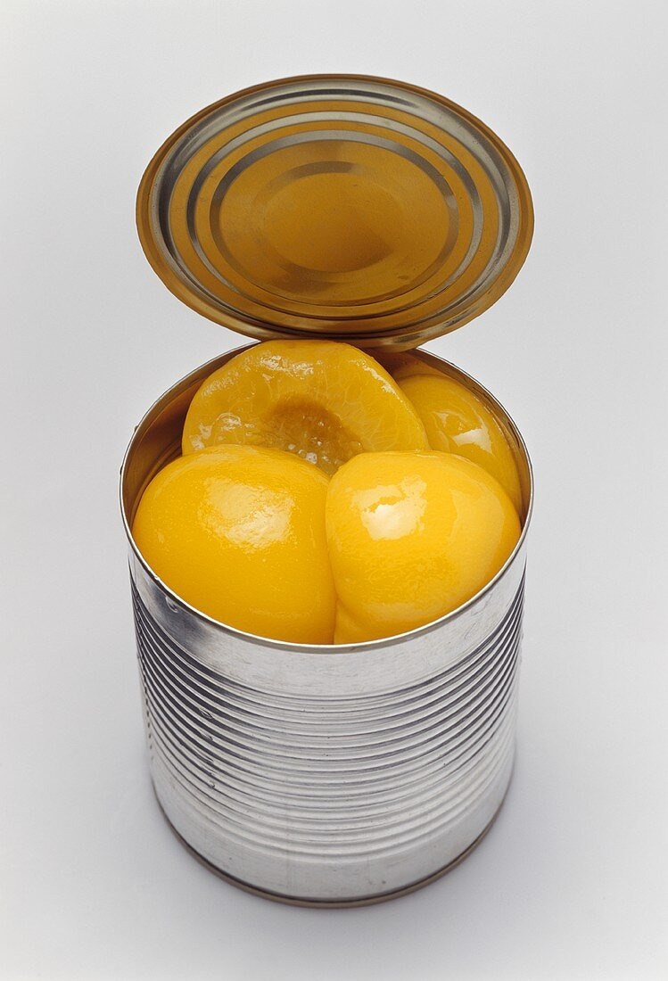 Peaches in an opened tin
