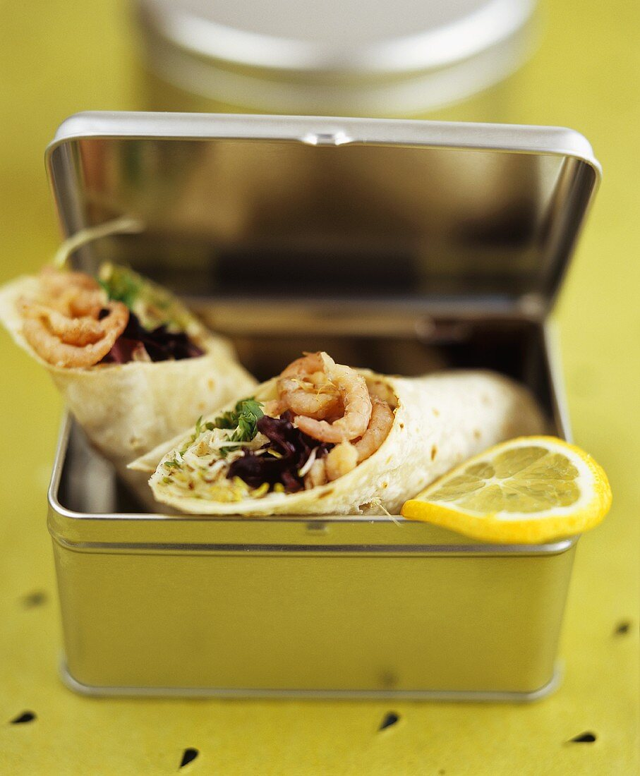 Wraps with shrimp salad filling in lunchbox