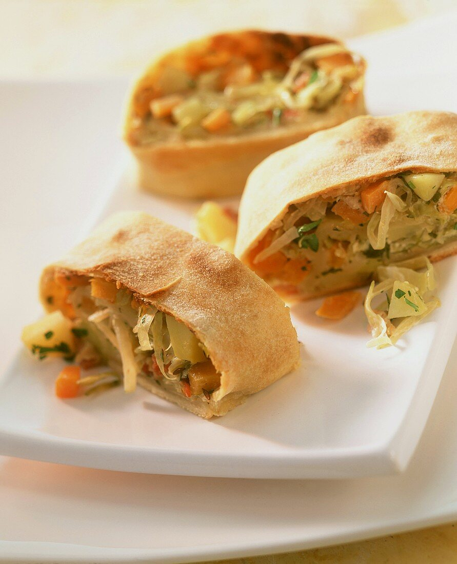 Strudel with potato and herb filling, cut into pieces
