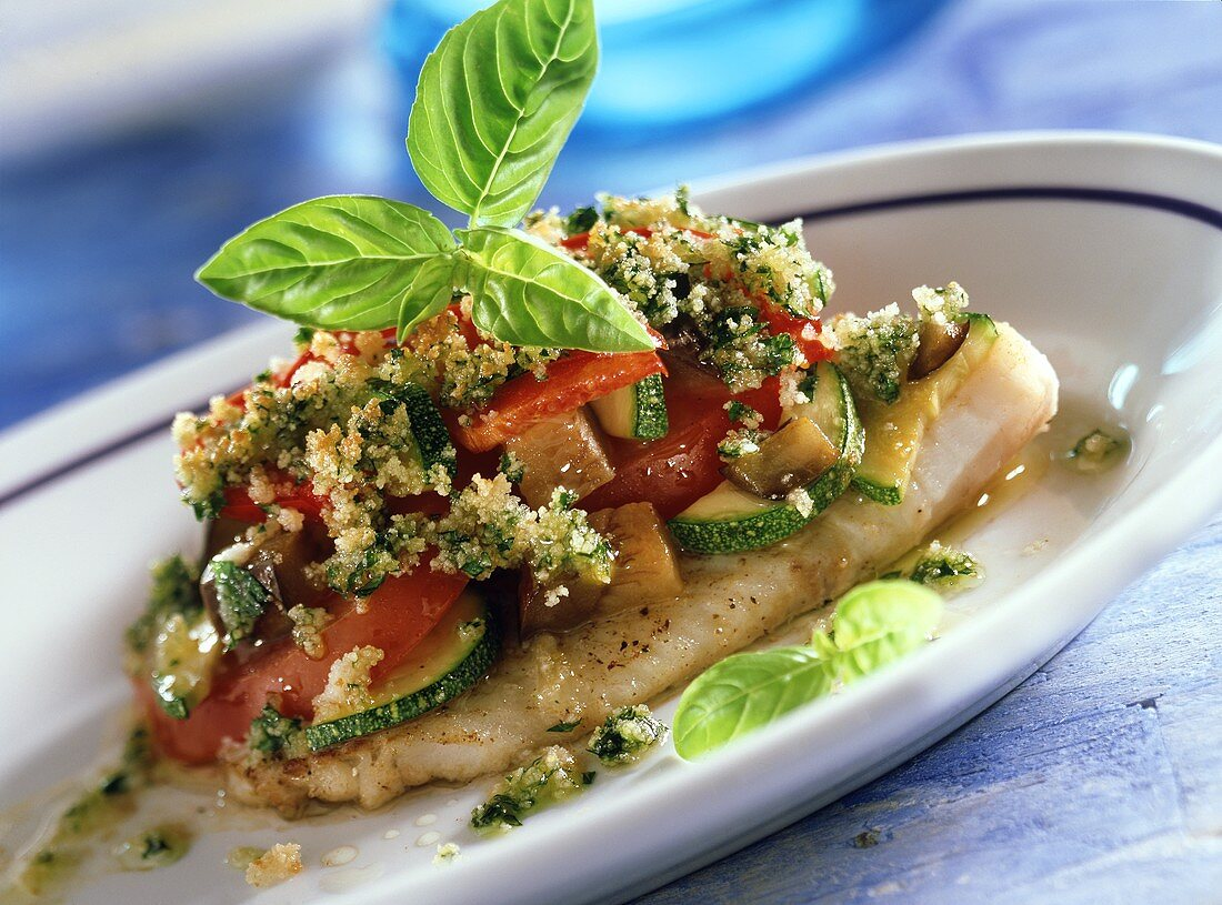 Oven-baked redfish fillet with Provencal vegetables
