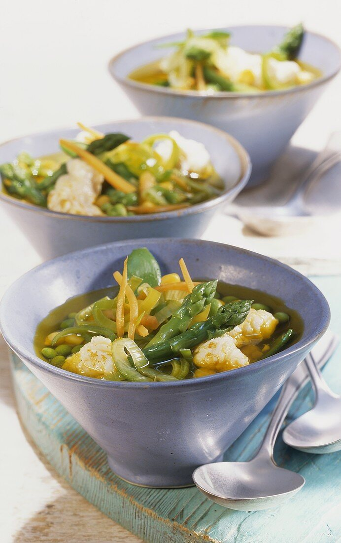 Fish soup with curry and vegetables