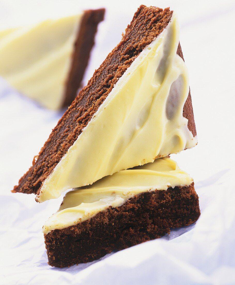 Chocolate cake with avocado cream, cut into pieces