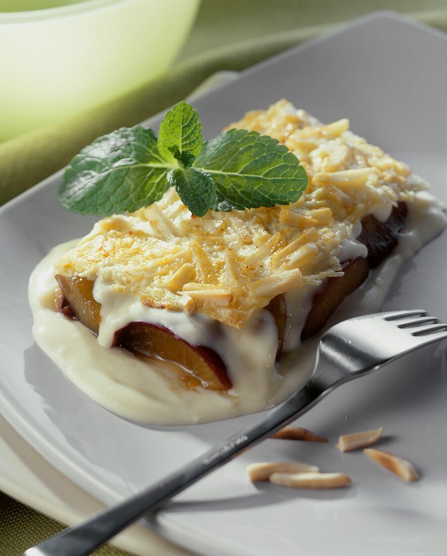 Plum lasagne with almonds and vanilla mousse