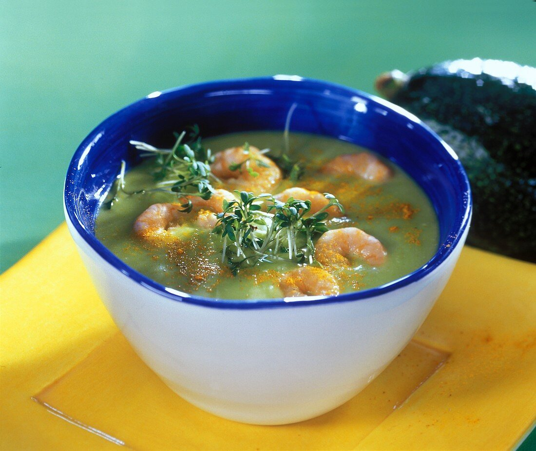 Warm avocado soup with shrimps