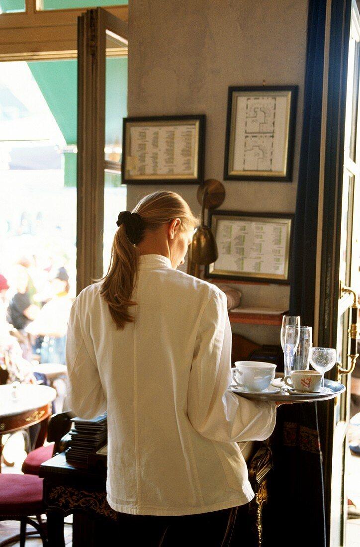 Back view of a waitress in Café Tambosi, Munich