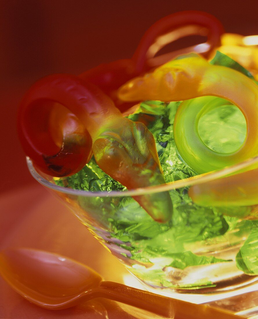 Green jelly with fruit jelly snakes