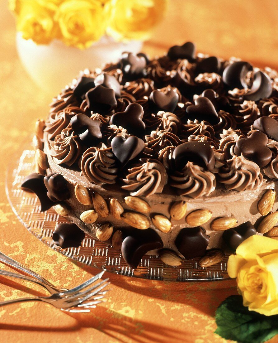 An almond chocolate gateau, decorated with chocolates