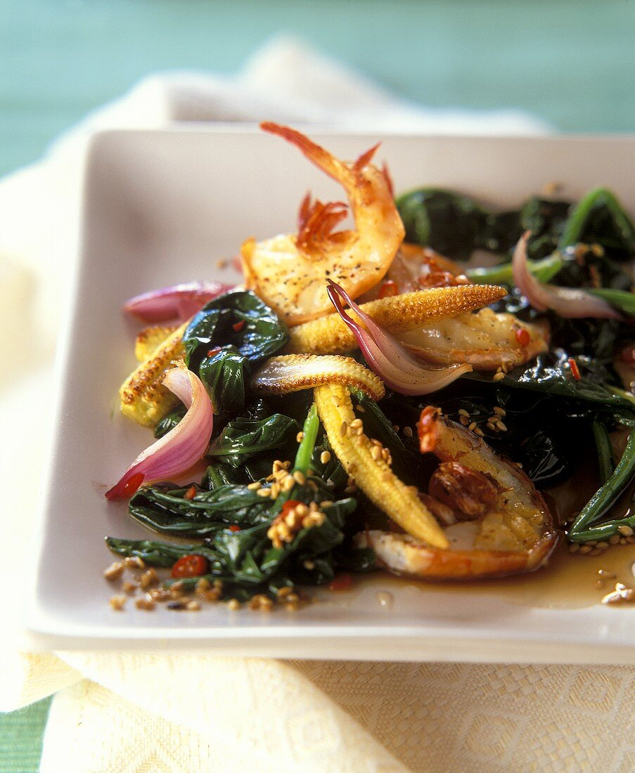 Asian pan-cooked spinach dish with baby corn cobs and shrimps