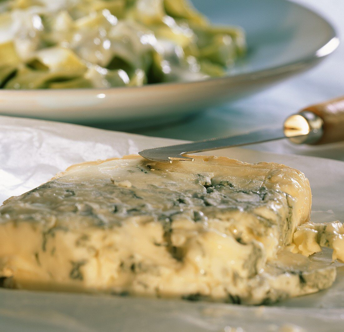 Gorgonzola with cheese knife on paper