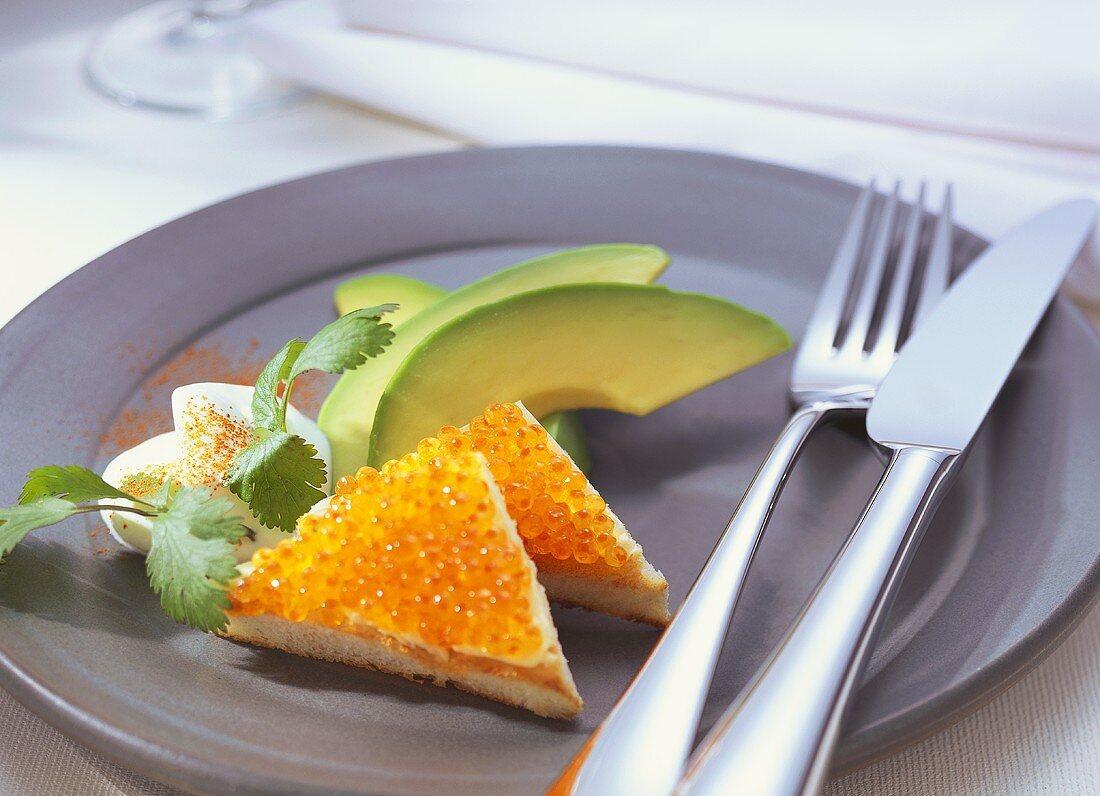 Caviare & toast with avocado fan