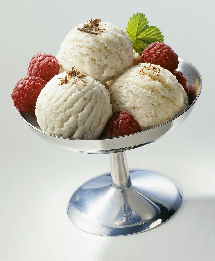 Almond ice cream, garnished with raspberries & mint leaves