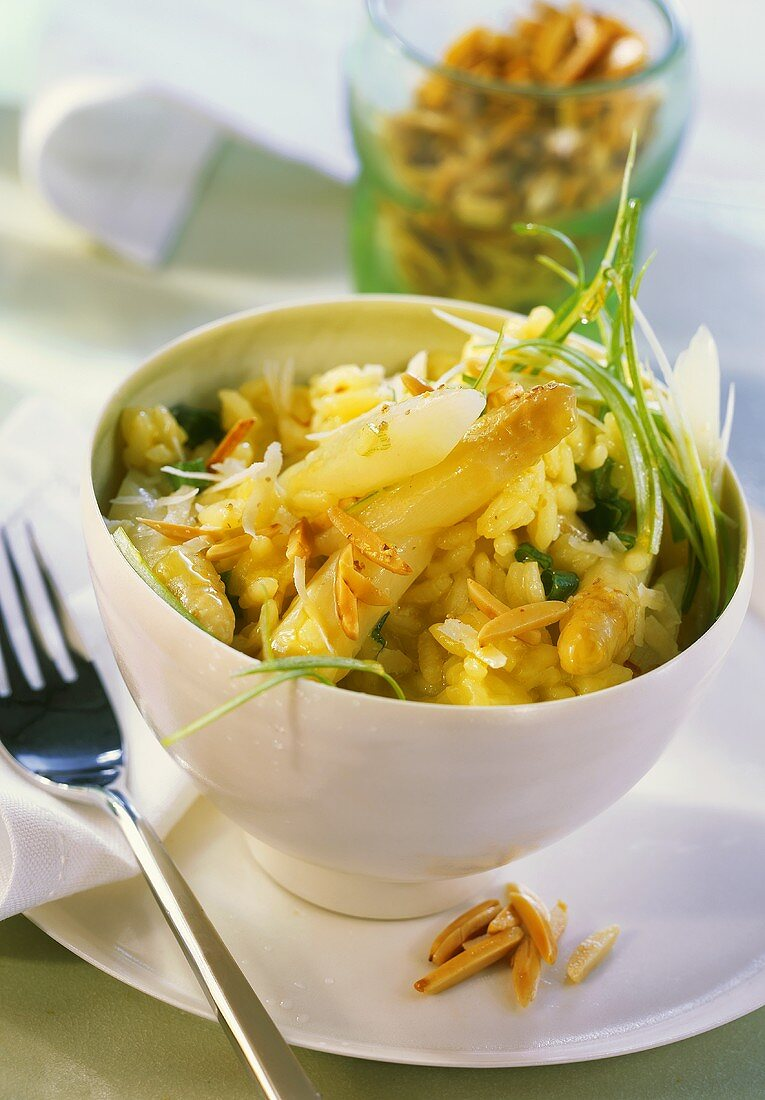 Asparagus risotto with spring onions and almond slivers