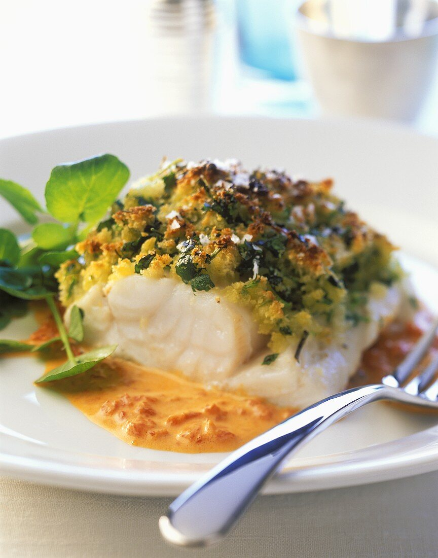 Fish fillet with herb crust and red pepper sauce
