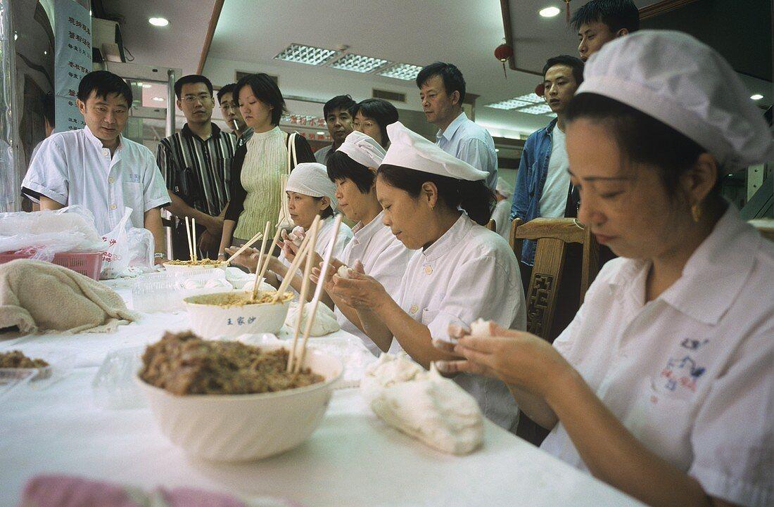 Chinese women making pasties (Shanghai)