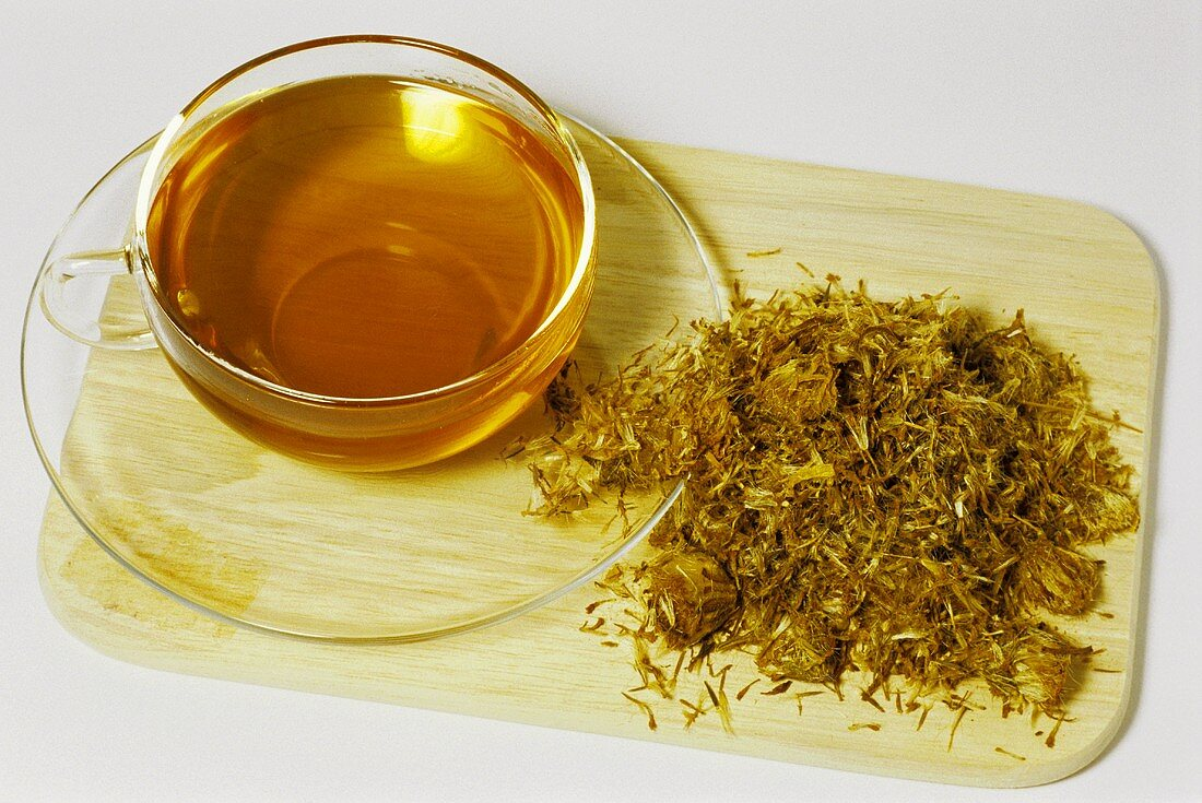 Arnica tea and dried flowers (Arnica montana)