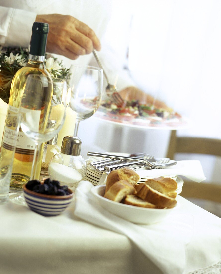 Buffet Table with Wine and Bread