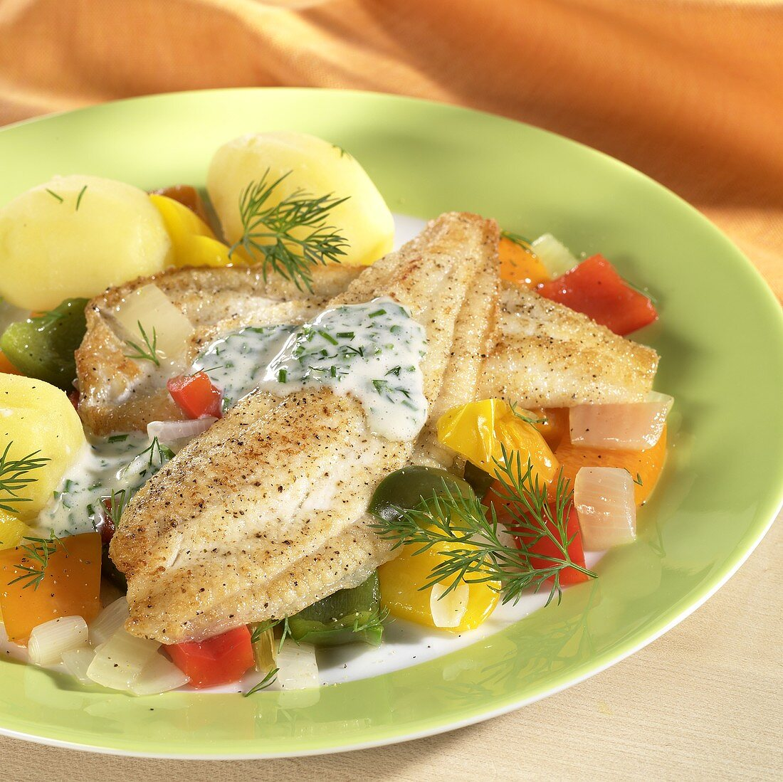 Plaice fillet with boiled potatoes & dill on vegetables