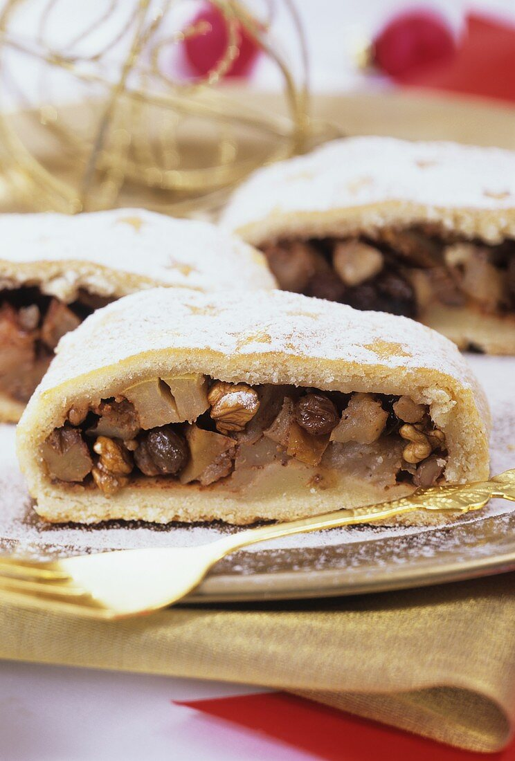Three pieces of apple strudel, decorated for Christmas