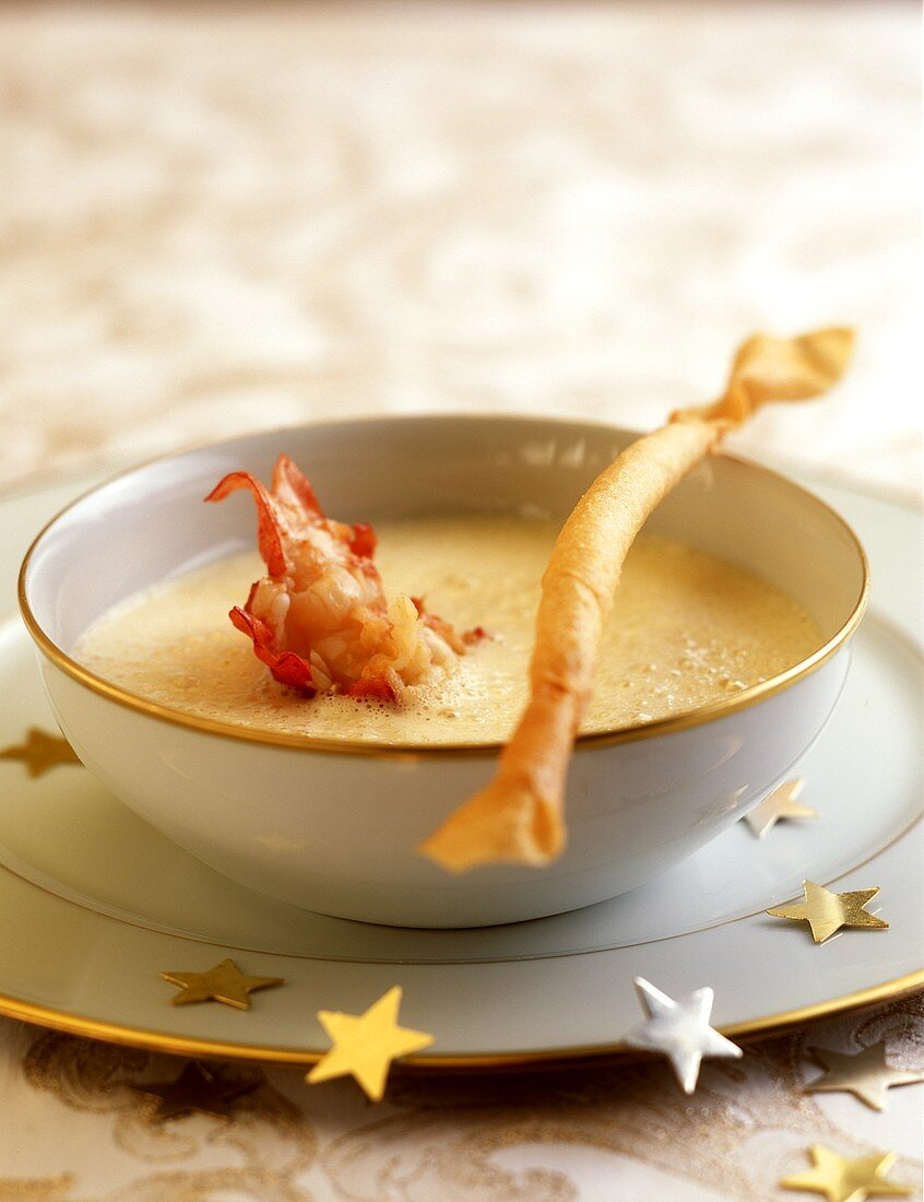 Parmesan soup with cooked crab tails