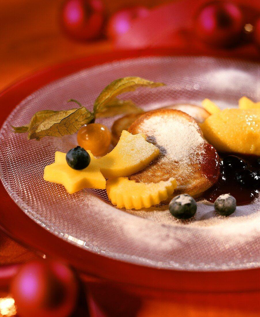 Quark pancakes with berry sauce and mango ice cream