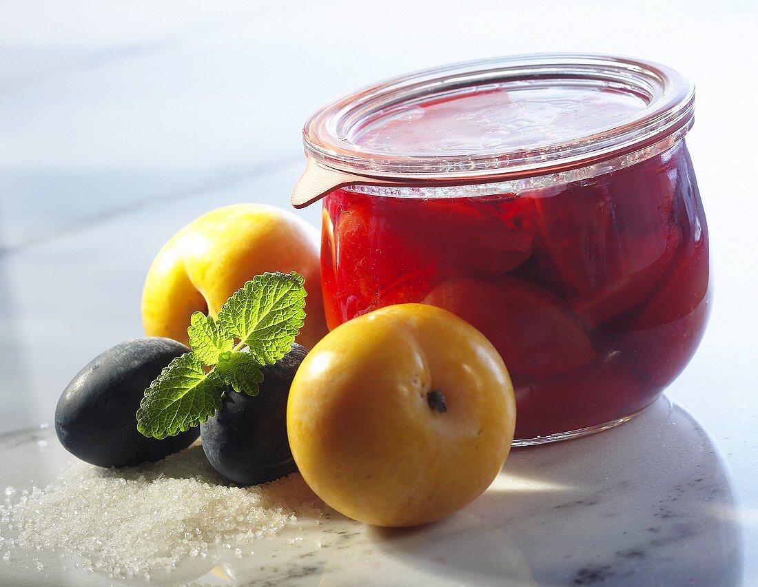 Bottled plums in a jar