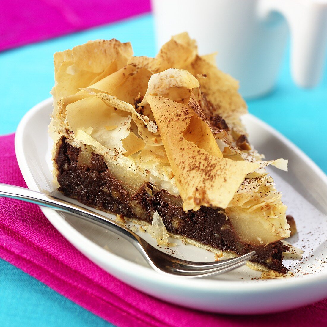 Piece of chocolate pear cake with strudel pastry