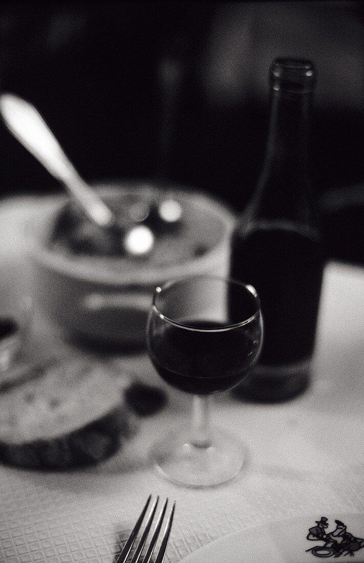 Red wine, glass in a 'Bouchon lyonnais' (simple bistro, Lyon)