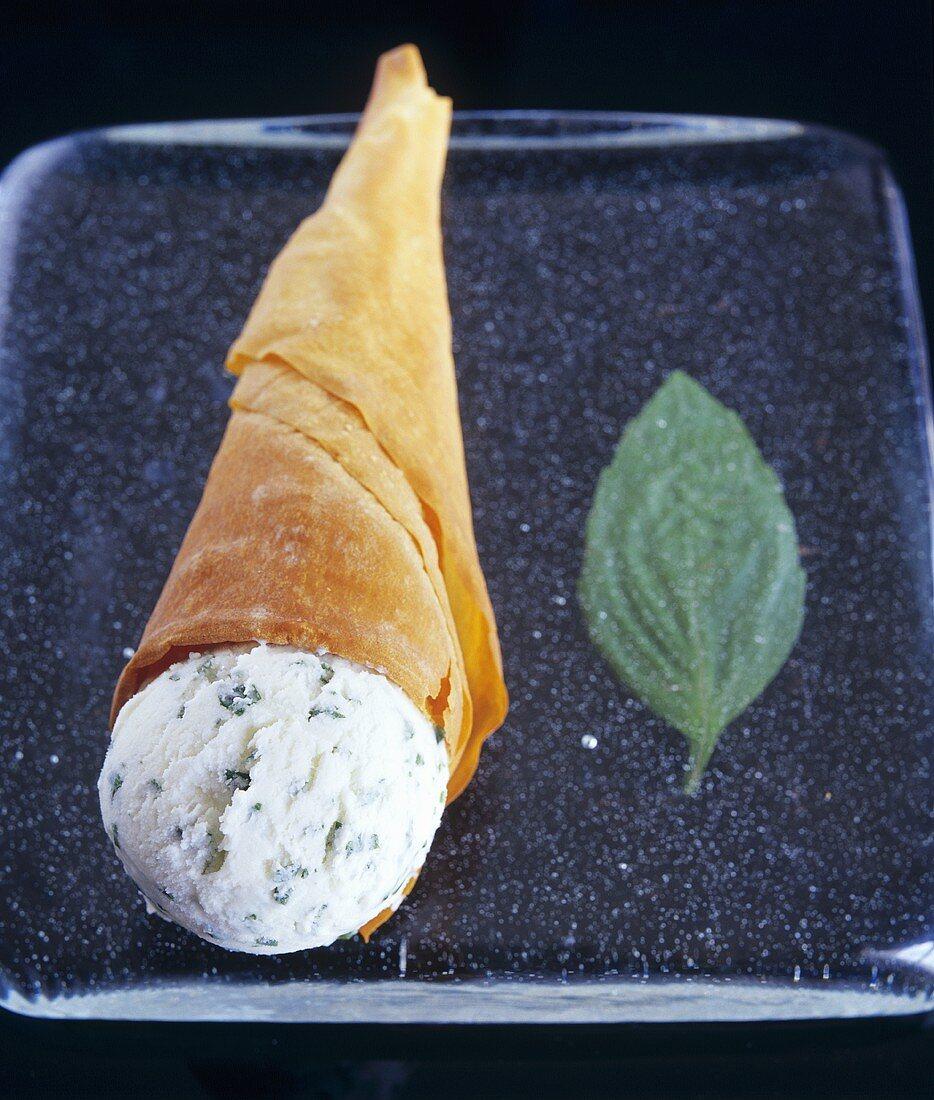 Mascarpone and basil ice cream in wafer cone