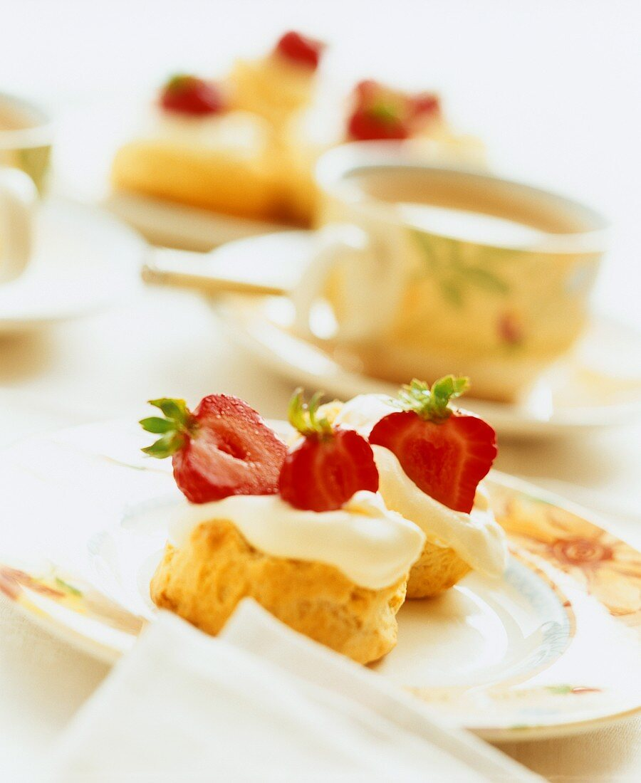 Scones with strawberries and cream and a cup of tea