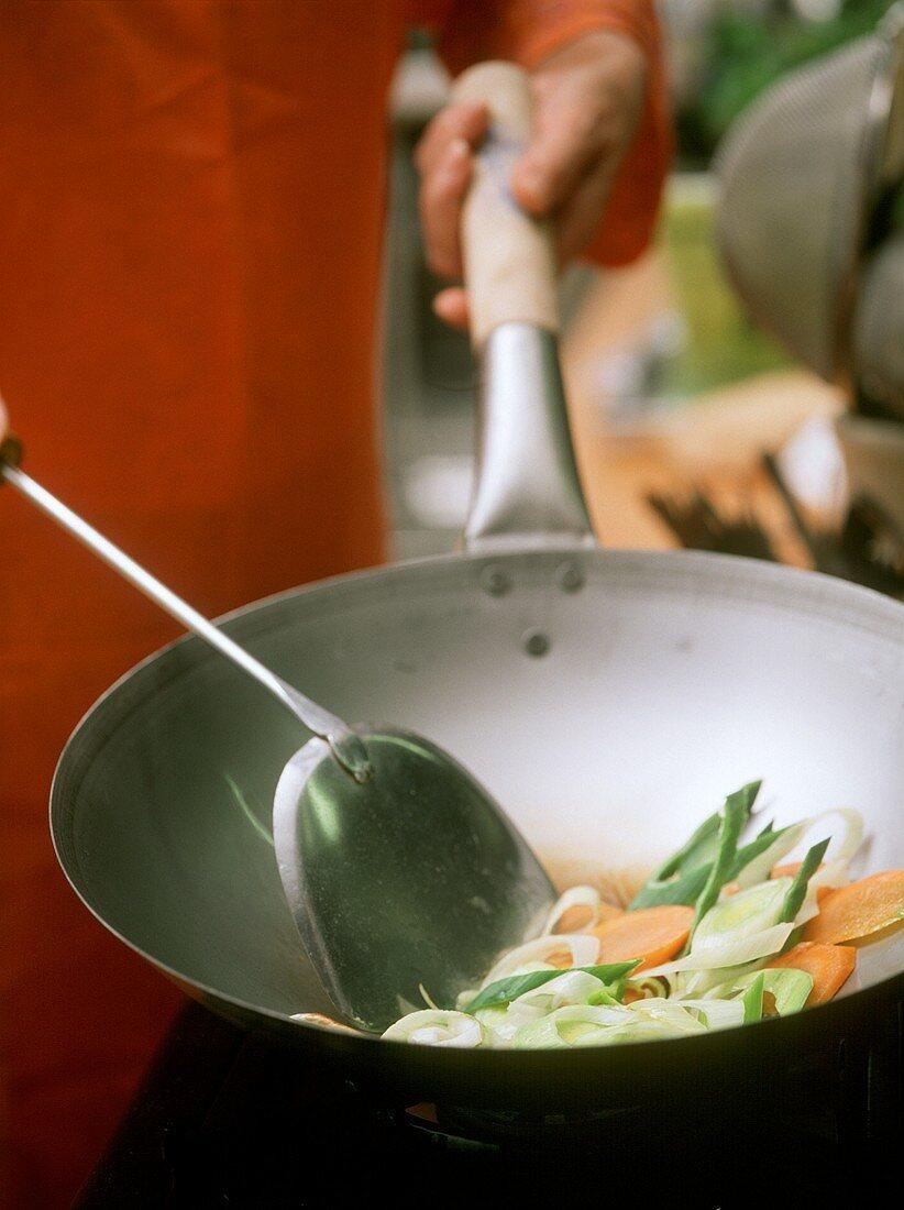 Stir-frying vegetables in wok