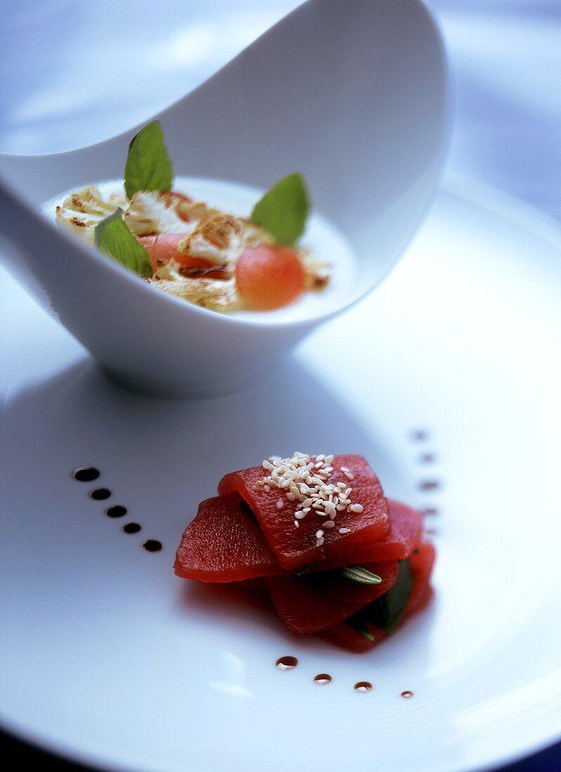 Slices of raw tuna with sesame and cauliflower cream