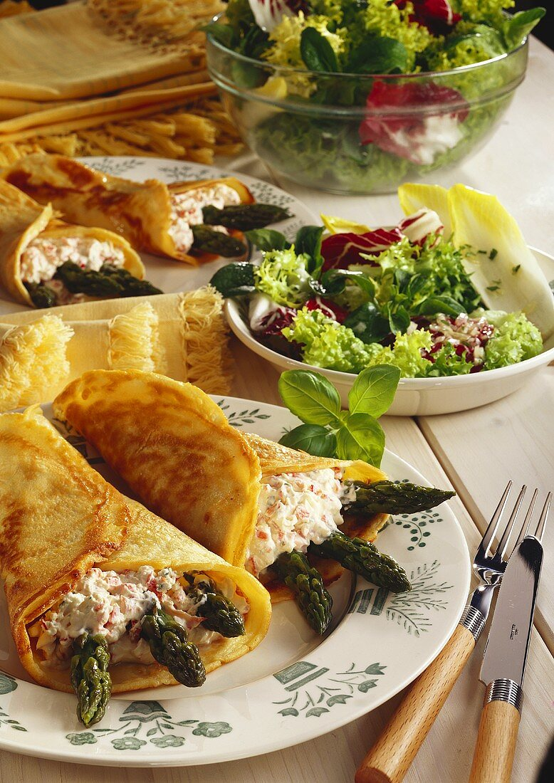 Pancakes rolls with cheese mousse and green asparagus
