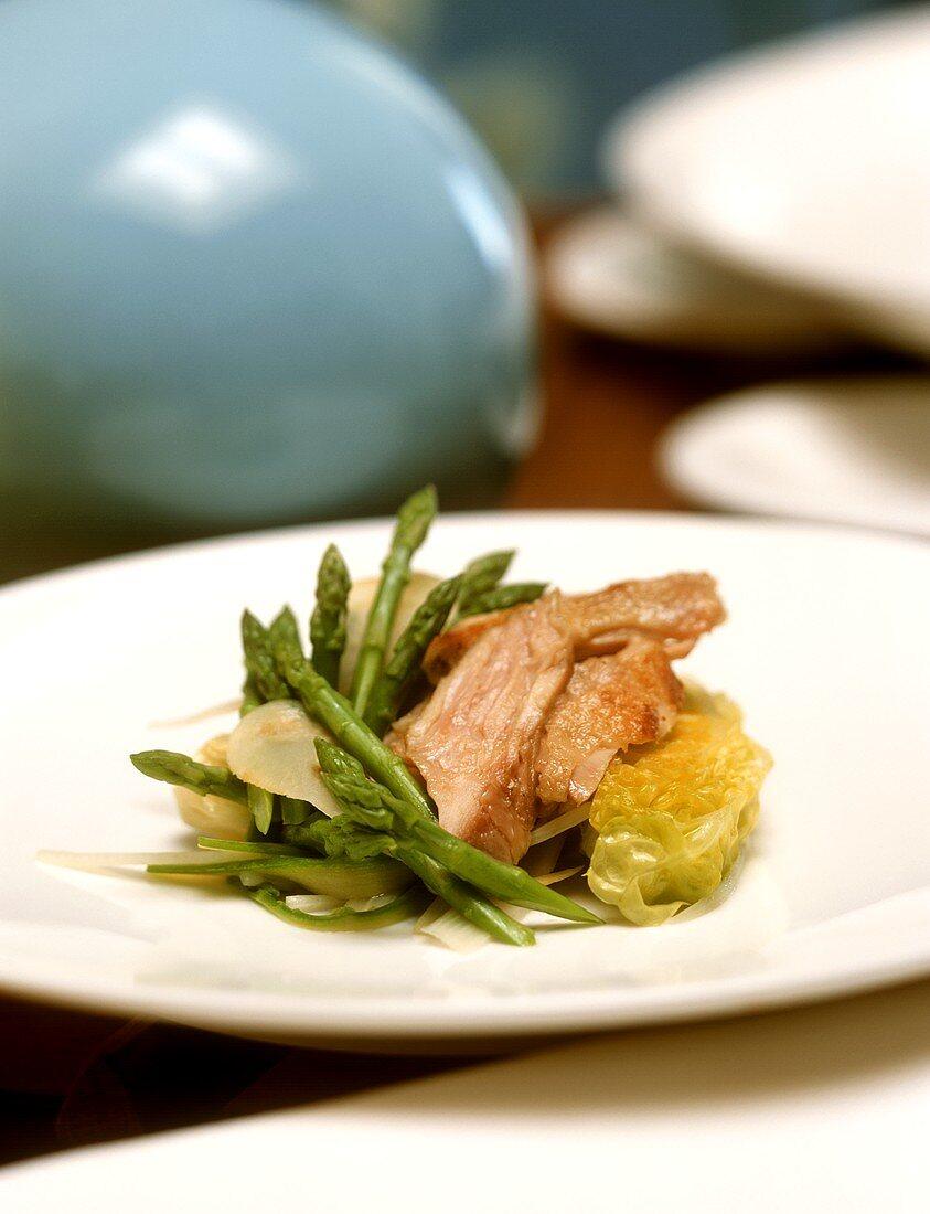 Corn-fed chicken breast on asparagus salad