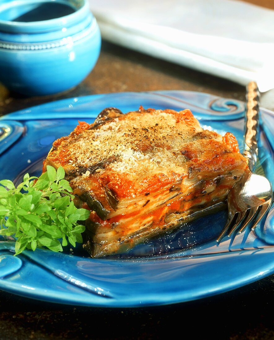 A piece of aubergine and tomato bake