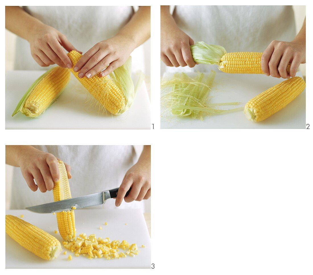 Scraping grains of corn from the cob