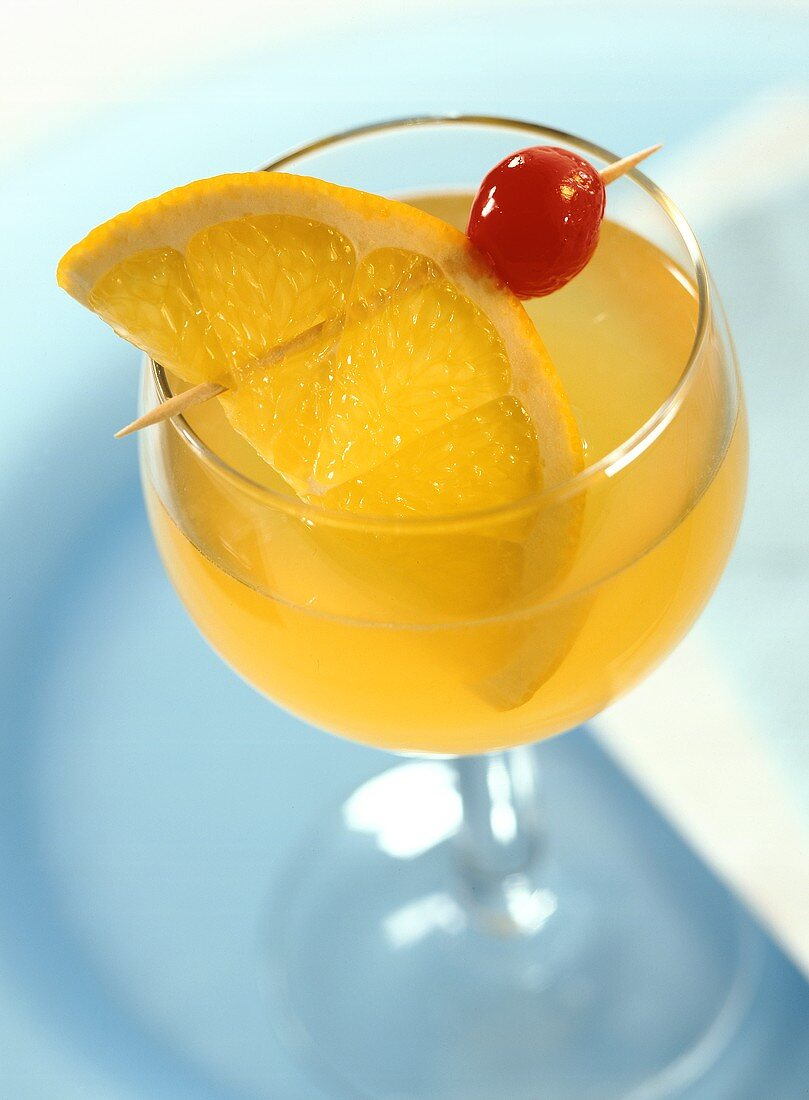 Whisky Sour in cocktail glass with slice of orange and cherry